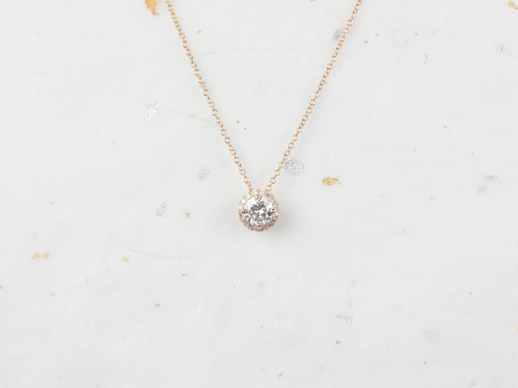 https://www.loveandpromisejewelers.com/media/catalog/product/cache/feefdef027ccf0d59dd1fef51db0610e/r/o/rosados_box_gemma_5mm_14kt_rose_gold_round_f1-_moissanite_and_diamonds_halo_floating_necklace_4__1.jpg