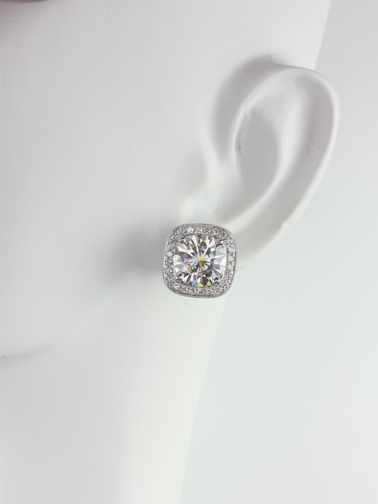 https://www.loveandpromisejewelers.com/media/catalog/product/cache/feefdef027ccf0d59dd1fef51db0610e/r/o/rosados_box_rheine_8mm_14kt_gold_round_forever_one_moissanite_diamonds_cushion_with_milgrain_halo_stud_earrings_1_.jpg