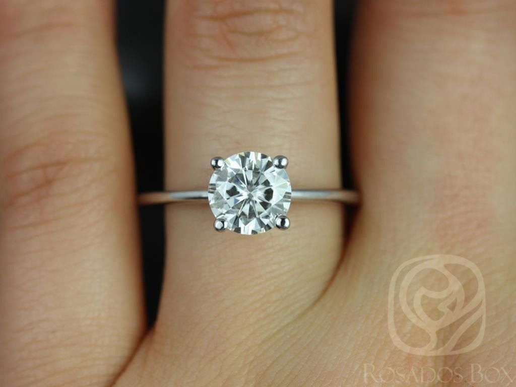 https://www.loveandpromisejewelers.com/media/catalog/product/cache/feefdef027ccf0d59dd1fef51db0610e/s/k/skinny_alberta_7.5mm_14kt_white_gold_round_fb_moissanite_tulip_solitaire_engagement_ring_other_metals_and_stone_options_available_3wm.jpg