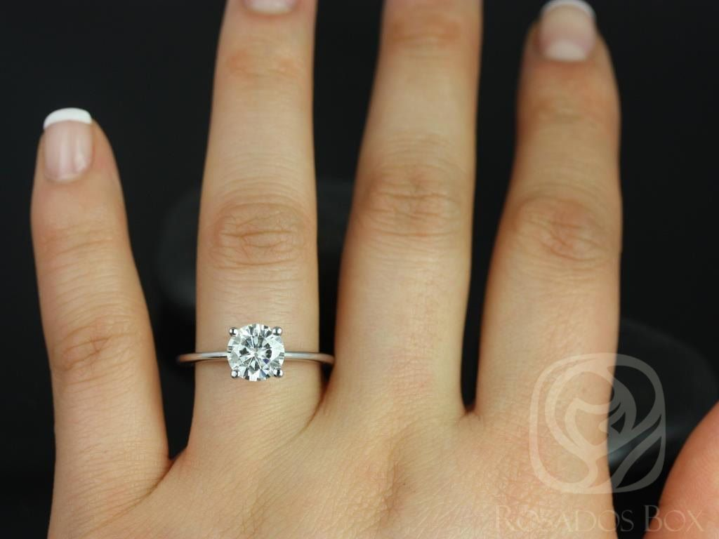 https://www.loveandpromisejewelers.com/media/catalog/product/cache/feefdef027ccf0d59dd1fef51db0610e/s/k/skinny_alberta_7.5mm_14kt_white_gold_round_fb_moissanite_tulip_solitaire_engagement_ring_other_metals_and_stone_options_available_4wm.jpg