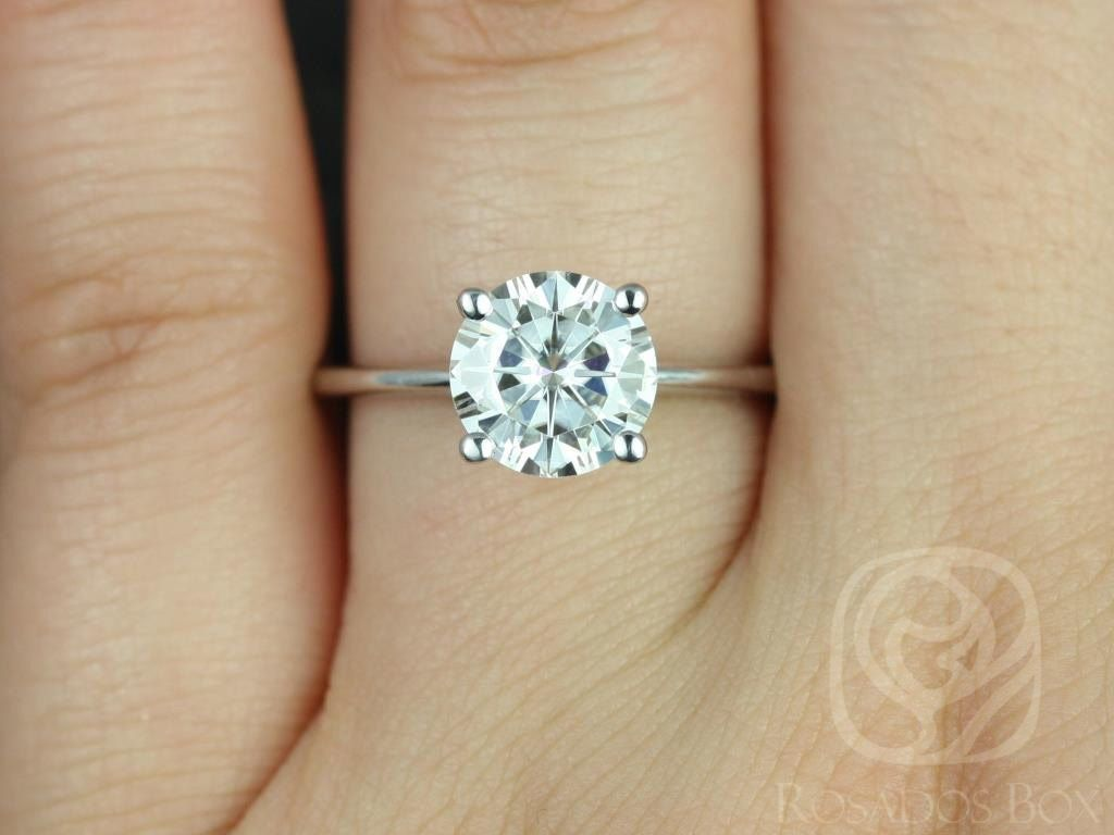 https://www.loveandpromisejewelers.com/media/catalog/product/cache/feefdef027ccf0d59dd1fef51db0610e/s/k/skinny_alberta_8mm_14kt_white_gold_round_fb_moissanite_tulip_solitaire_engagement_ring_other_metals_and_stone_options_available_3wm.jpg