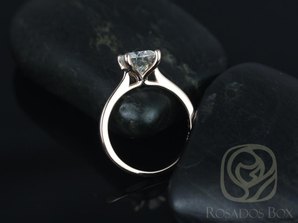 https://www.loveandpromisejewelers.com/media/catalog/product/cache/feefdef027ccf0d59dd1fef51db0610e/s/k/skinny_flora_7.5mm_14kt_rose_gold_round_fb_moissanite_tulip_cathedral_solitaire_engagement_ring_2wm.jpg