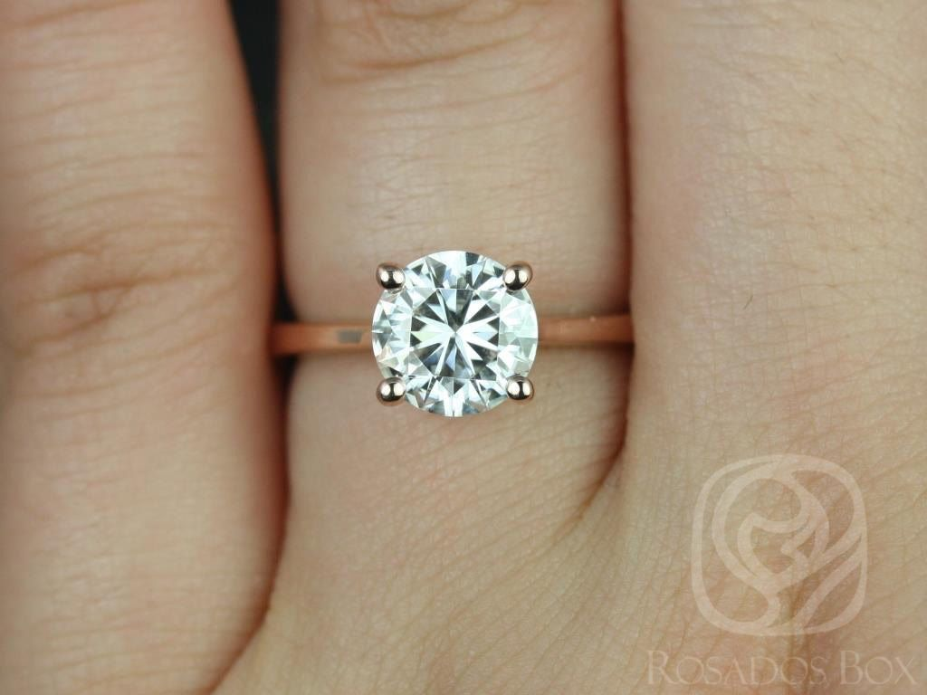 https://www.loveandpromisejewelers.com/media/catalog/product/cache/feefdef027ccf0d59dd1fef51db0610e/s/k/skinny_flora_7.5mm_14kt_rose_gold_round_fb_moissanite_tulip_cathedral_solitaire_engagement_ring_3wm.jpg