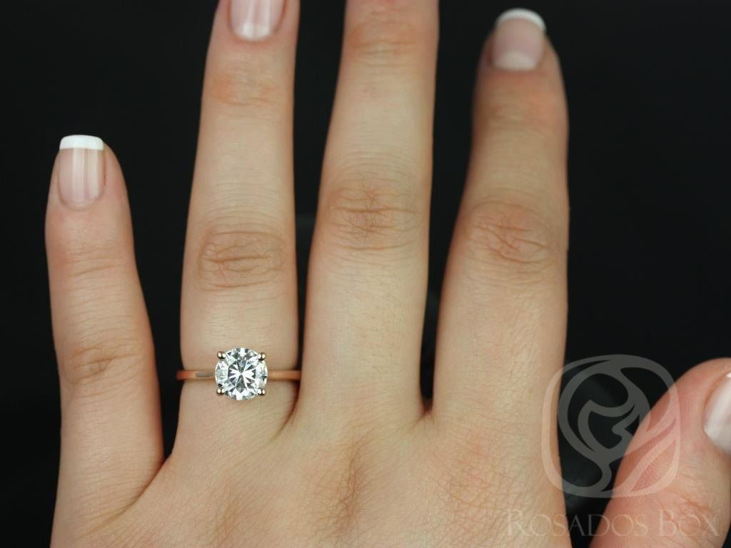 https://www.loveandpromisejewelers.com/media/catalog/product/cache/feefdef027ccf0d59dd1fef51db0610e/s/k/skinny_flora_7.5mm_14kt_rose_gold_round_fb_moissanite_tulip_cathedral_solitaire_engagement_ring_4wm.jpg