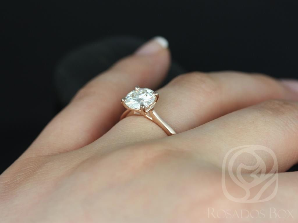 https://www.loveandpromisejewelers.com/media/catalog/product/cache/feefdef027ccf0d59dd1fef51db0610e/s/k/skinny_flora_7.5mm_14kt_rose_gold_round_fb_moissanite_tulip_cathedral_solitaire_engagement_ring_5wm.jpg