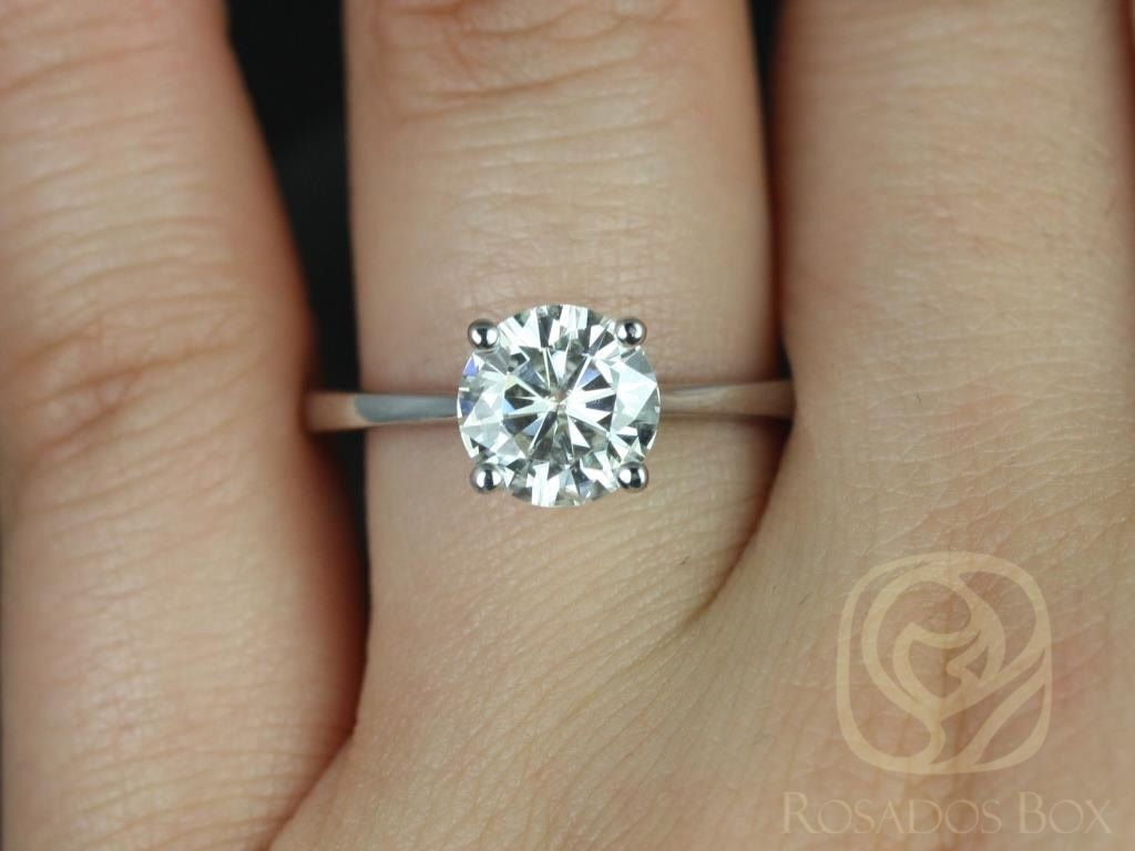 https://www.loveandpromisejewelers.com/media/catalog/product/cache/feefdef027ccf0d59dd1fef51db0610e/s/k/skinny_flora_8mm_14kt_white_gold_round_fb_moissanite_tulip_cathedral_solitaire_engagement_ring_3wm.jpg
