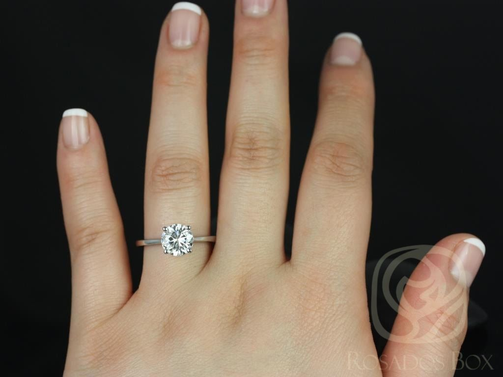 https://www.loveandpromisejewelers.com/media/catalog/product/cache/feefdef027ccf0d59dd1fef51db0610e/s/k/skinny_flora_8mm_14kt_white_gold_round_fb_moissanite_tulip_cathedral_solitaire_engagement_ring_4wm.jpg