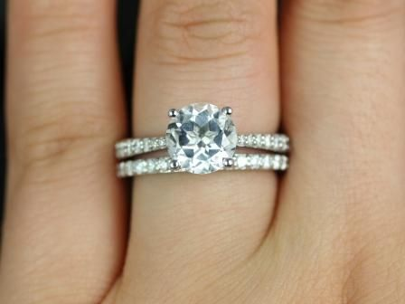 https://www.loveandpromisejewelers.com/media/catalog/product/cache/feefdef027ccf0d59dd1fef51db0610e/t/a/taylor_medio_size_round_white_topaz_wedding_set_1_.jpg