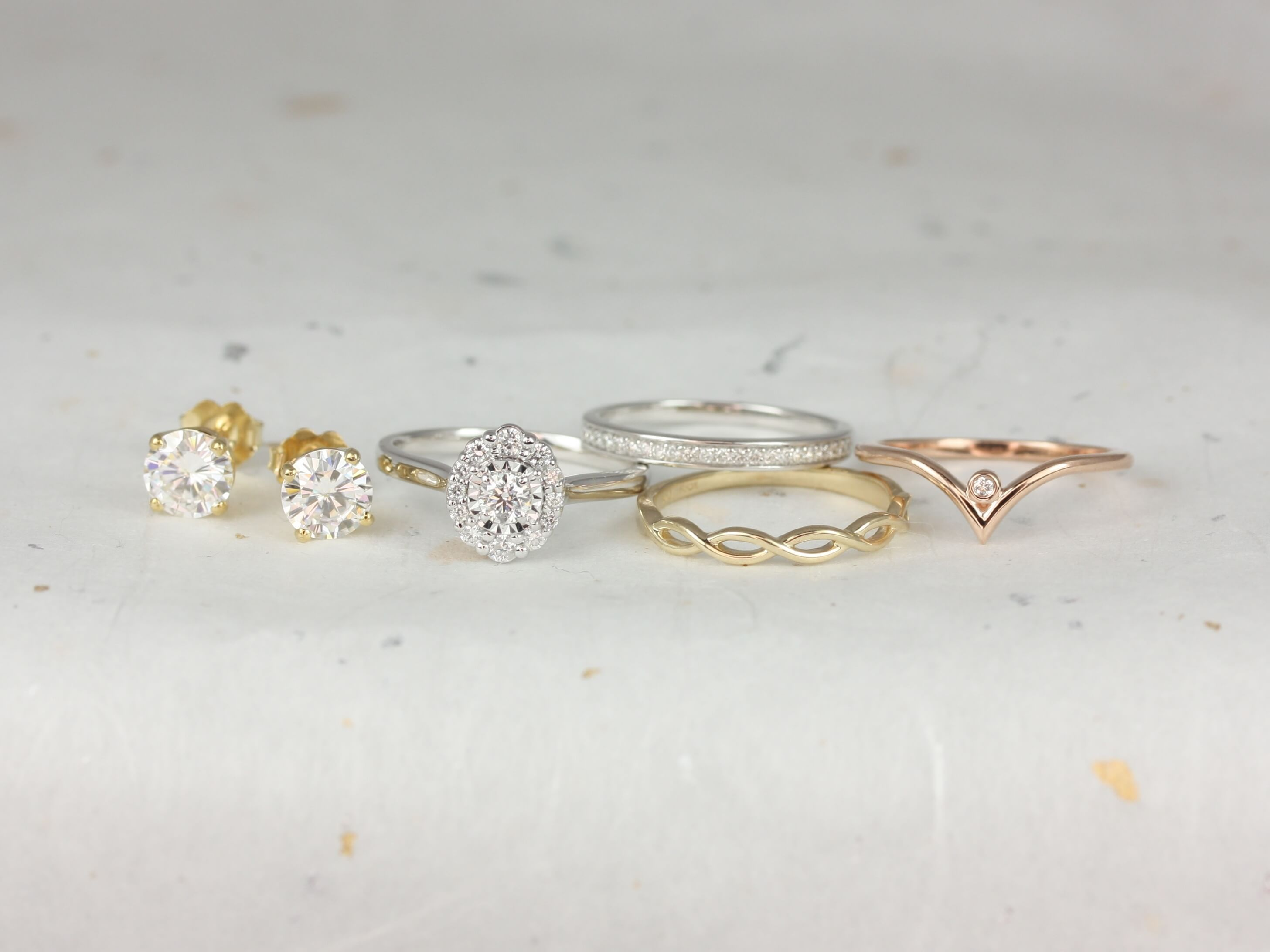 Collection of differently shaped and colored rings and earrings.